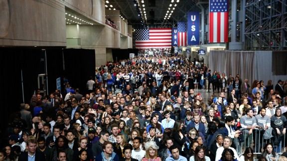 People watch voting results at the Javits Center in New York.