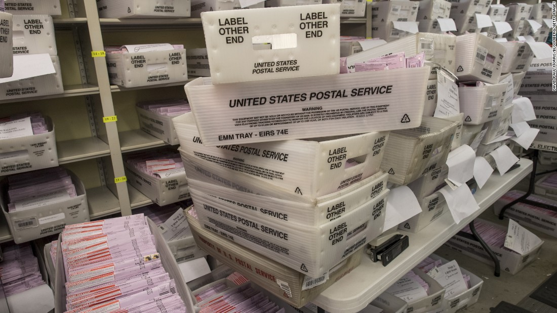 Boxes containing mail-in ballots sit waiting to be sorted at the San Francisco City Hall polling location.