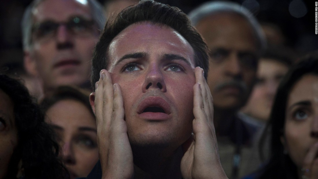 A man reacts as he watches voting results at the Javits Center.
