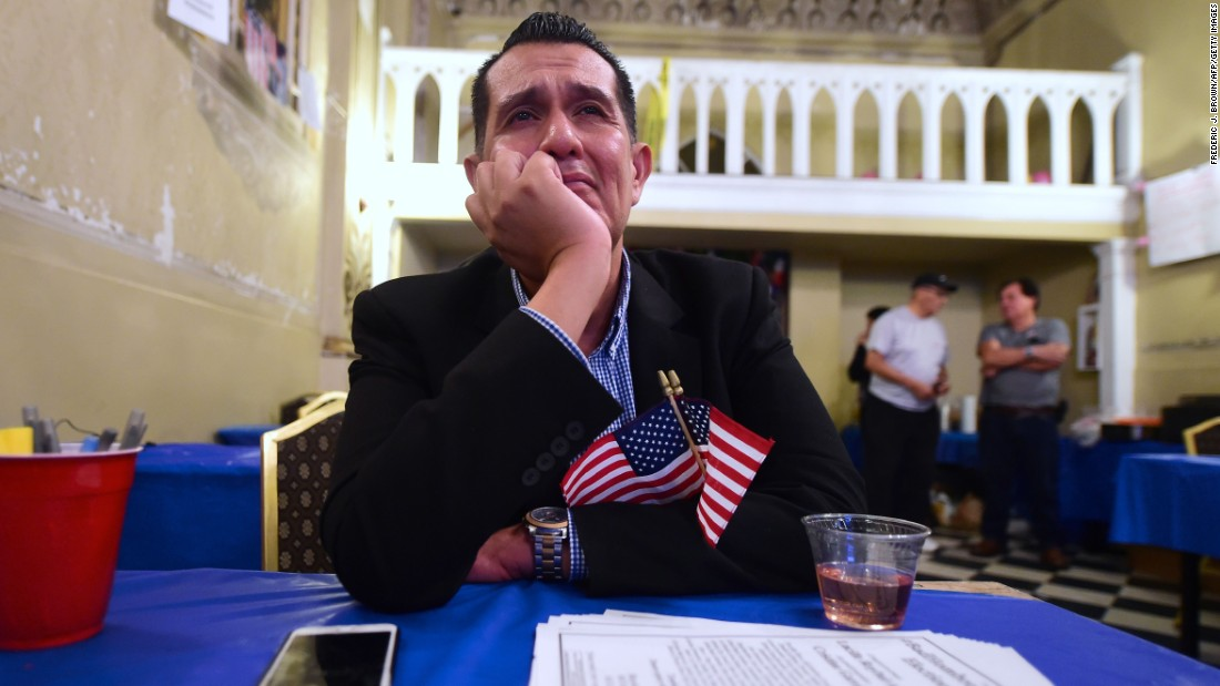 An emotional Gerardo Ruiz watches the election results from Clinton's headquarters in east Los Angeles.