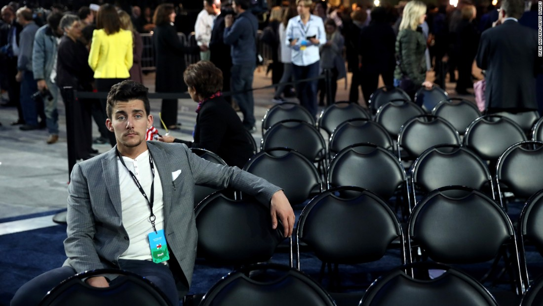 A person sits at the Javits Center, the site of Clinton's election night event in New York.
