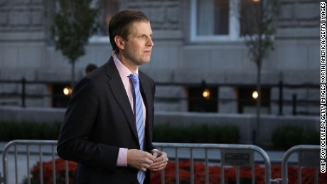 WASHINGTON, DC - OCTOBER 26:  Eric Trump, son of Republican presidential nominee Donald Trump, does a television interview before the ribbon cutting ceremony during the grand opening of the new Trump International Hotel October 26, 2016 in Washington, DC. The hotel, built inside the historic Old Post Office, has 263 luxry rooms, including the 6,300-square-foot 'Trump Townhouse' at $100,000 a night, with a five-night minimum. The Trump Organization was granted a 60-year lease to the historic building by the federal government before the billionaire New York real estate mogul announced his intent to run for president.  (Photo by Chip Somodevilla/Getty Images)