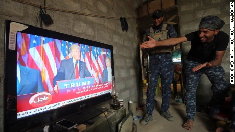 Members of the Iraqi forces react as they watch Donald Trump giving a speech after he won the US president elections in the village of Arbid on the southern outskirts of Mosul on November 9, 2016, as they rest in a house during the ongoing military operation to retake Mosul from the Islamic State (IS) group.   Iraqi Prime Minister Haider al-Abadi congratulated Donald Trump on his election as president and said he hoped for continued US and international support in the war against jihadists.   / AFP / AHMAD AL-RUBAYE        (Photo credit should read AHMAD AL-RUBAYE/AFP/Getty Images)