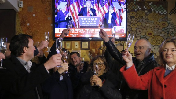 Slovenians toast Donald Trump's victory in Sevnica, the hometown of Trump's wife, Melania, during a broadcast of his acceptance speech on Wednesday, November 9. Trump defeated Democratic presidential nominee Hillary Clinton and will become the 45th president of the United States.