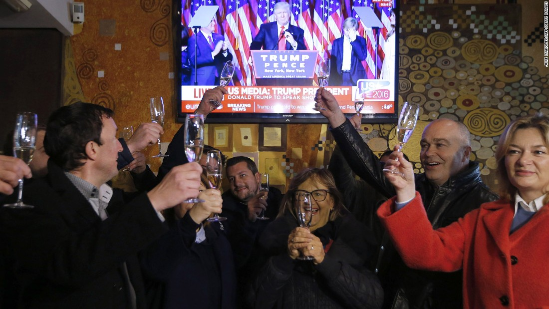 "Slovenians toast Donald Trump's victory in Sevnica, the hometown of Trump's wife, Melania, during a broadcast of <a href=""http://www.cnn.com/2016/11/09/politics/donald-trump-acceptance-speech/"" target=""_blank"">his acceptance speech</a> on Wednesday, November 9. Trump defeated Democratic presidential nominee Hillary Clinton and will become the 45th president of the United States."