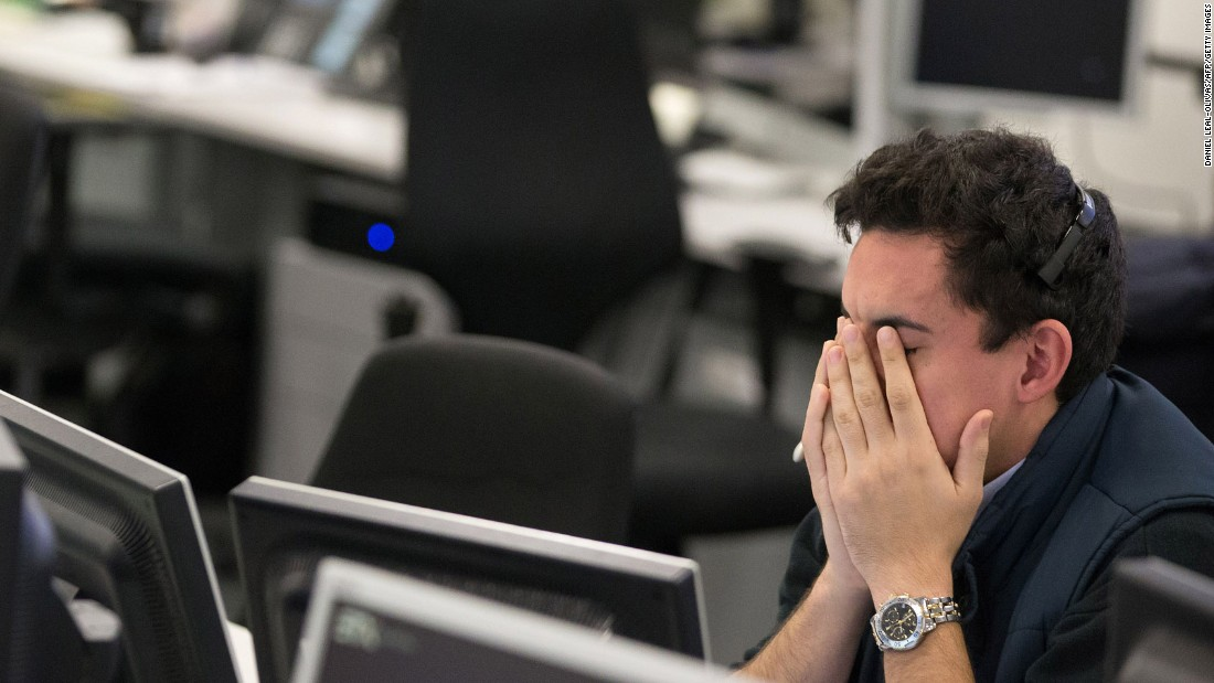 A trader from ETX Capital reacts in London following the election result.