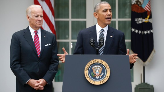 President Barack Obama, accompanied by Vice President Joe Biden, speaks in the election, Wednesday, Nov. 9, 2016, in the Rose Garden of the White House in Washington.