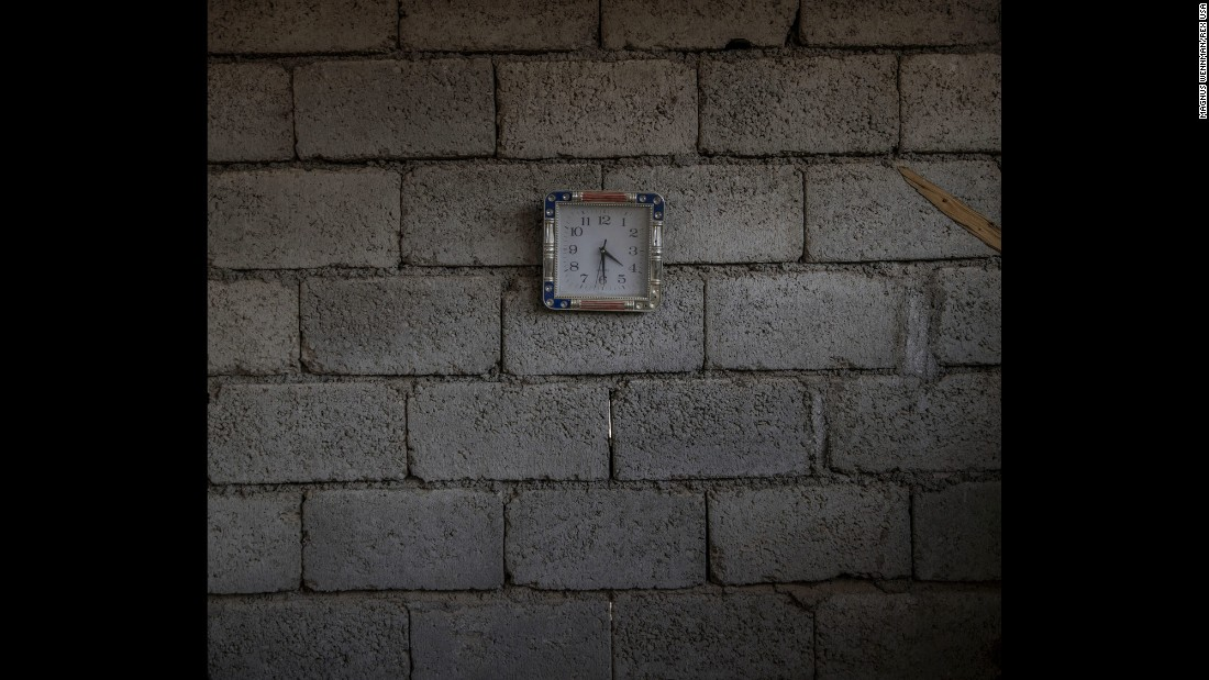 A small clock still hangs on the wall of an abandoned house on the outskirts of Mosul.