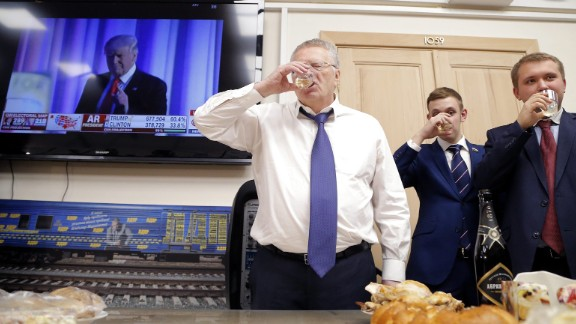 Vladimir Zhirinovsky, leader of the Liberal Democratic Party of Russia, left, toasts in front of a TV screening Trump's acceptance speech on November 9.