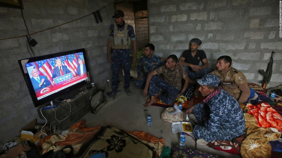 Iraqi troops watch a broadcast of Donald Trump's acceptance speech in a house in Arbid, on the outskirts of Mosul, on Wednesday, November 9. Iraqi Prime Minister Haider al-Abadi congratulated Trump on his win and said he hoped for continued support in the war on ISIS.