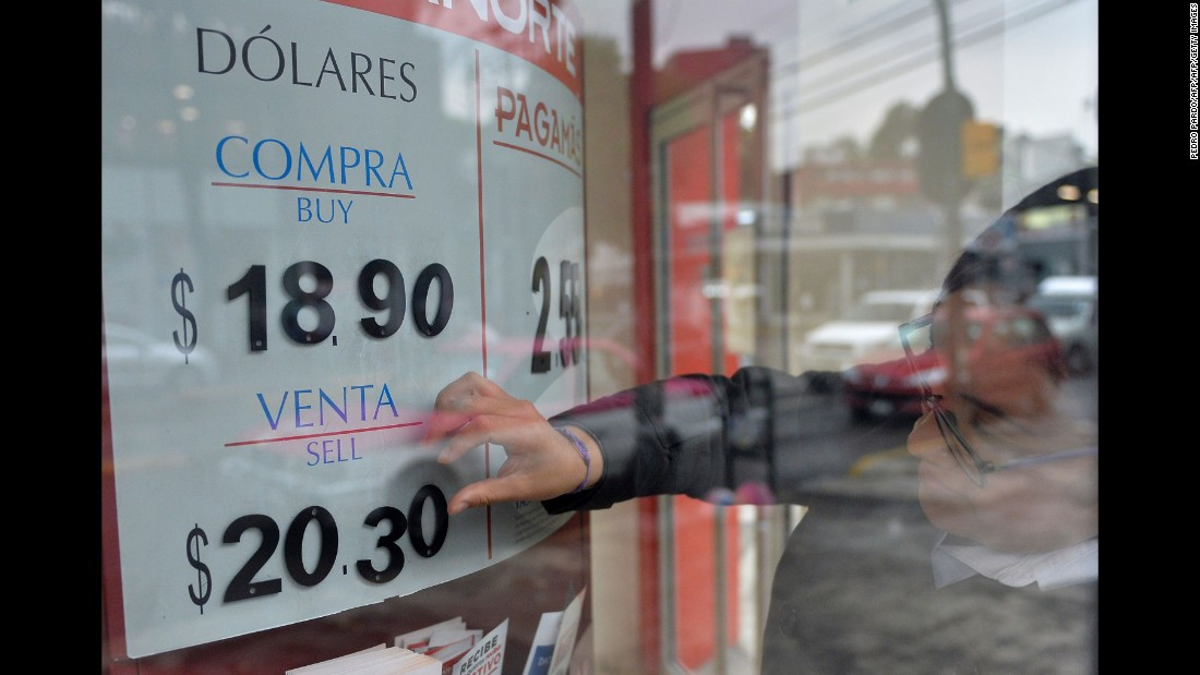 "The U.S. dollar exchange rate is seen on the board of a bank in Mexico City on November 9. The dollar tumbled against the yen and euro while the Mexican peso <a href=""http://money.cnn.com/2016/11/09/investing/mexican-peso-trump-us-election/"" target=""_blank"">fell off a cliff</a> as polling results pointed to a strong showing by Trump."