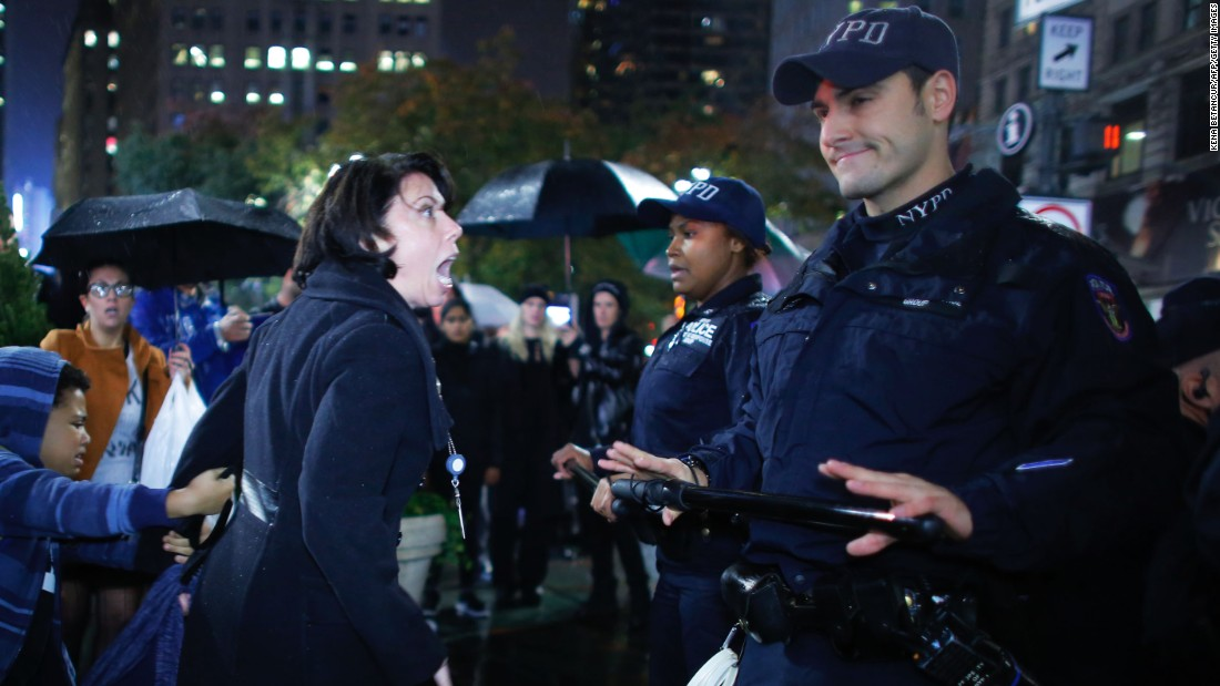 "A woman argues with police officers during a protest in New York on November 9. Erin Michelle Threlfall, the woman pictured, told <a href=""http://www.huffingtonpost.com/entry/5824aa40e4b0270d9a2ad89e?timestamp=1478799395467"" target=""_blank"">The Huffington Post </a>she was attempting to intervene on behalf of a man she says the police were beating."