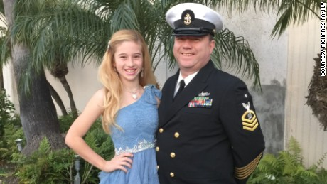 Isabelle poses with her sailor father