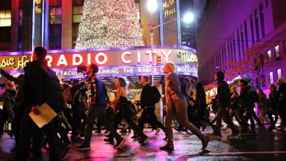 Demonstrators march past Radio City Music Hall in New York on November 9.