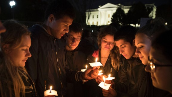 WASHINGTON, DC - NOVEMBER 09:  People gather for an anti-Donald Trump candlelight vigil in front of the White House November 9, 2016 in Washington, DC. President Barack Obama is scheduled to meet with President-elect Trump at the White House tomorrow.  (Photo by Alex Wong/Getty Images)
