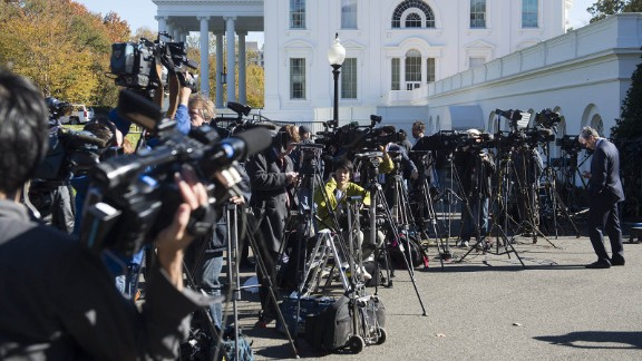Members of the press await the arrival of US President-elect Donald Trump for a meeting with US President Barack Obama at the White House in Washington, DC, November 10, 2016.