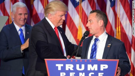 Chairman of the Republican National Committee (RNC) Reince Priebus (R) shakes hands with Republican presidential elect Donald Trump (C) as Republican candidate for Vice President Mike Pence looks on during election night at the New York Hilton Midtown in New York on November 9, 2016.