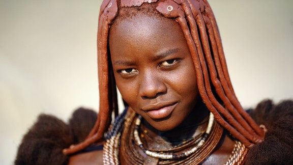 Women of the semi-nomadic Himba tribe in northern Namibia are famous for their reddish hair and complexion. It's the result of otjize, a paste of butter, fat and red ocher, applied daily to their hair and skin. It was once speculated that the otjize served as a form of sun protection and to ward off insects, however the women say it's purely for aesthetic reasons -- which makes sense, given that Himba men don't take part in the practice.