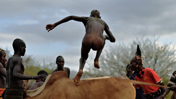 """Herdsmen become hurdlers in the Omo Valley, Ethiopia. Young men of the Hamar tribe, one of many in the valley, prove their manhood by jumping on prize bulls and then running across their backs -- all while naked. The purpose? It's a coming of age ceremony, and only when the participant has traversed the bull run four times will he be allowed to marry. Slip and you risk a hard fall: """"Because it's a manhood initiation ritual, [failure] is likely to affect the perception of someone's manhood and that of course can have all sorts of dire consequence,"""" adds Dr Lewis."""