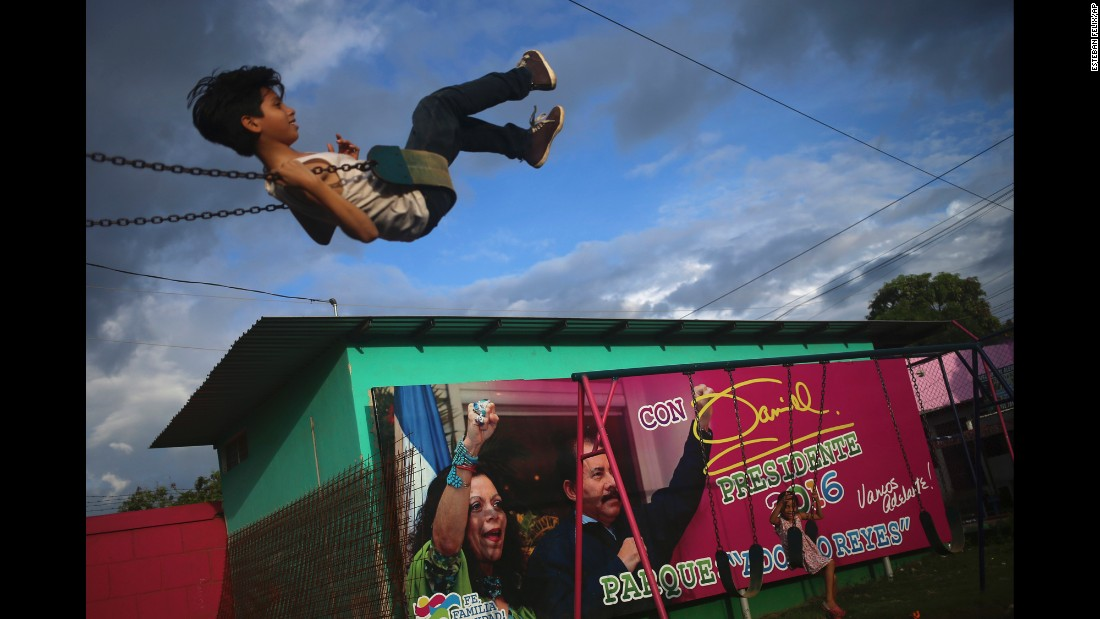 "Children swing near an election billboard promoting Nicaragua's President Daniel Ortega and his wife, Rosario Murillo, in Managua, Nicaragua, on Friday, November 4. <a href=""http://www.cnn.com/2016/11/06/americas/nicaragua-presidential-election/"" target=""_blank"">Ortega clinched a fourth term victory</a> that day, but this time with his wife as his running mate."