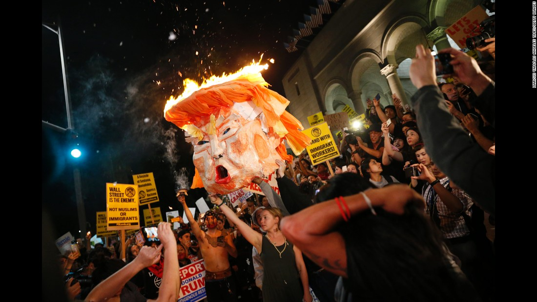 "Protesters set an effigy of Donald Trump afire outside Los Angeles City Hall on Wednesday, November 9. <a href=""http://www.cnn.com/2016/11/10/politics/election-results-reaction-streets/index.html"" target=""_blank"">Tens of thousands rallied in at least 25 US cities</a> to protest Trump's unexpected victory in the divisive 2016 presidential election. Dozens were arrested."
