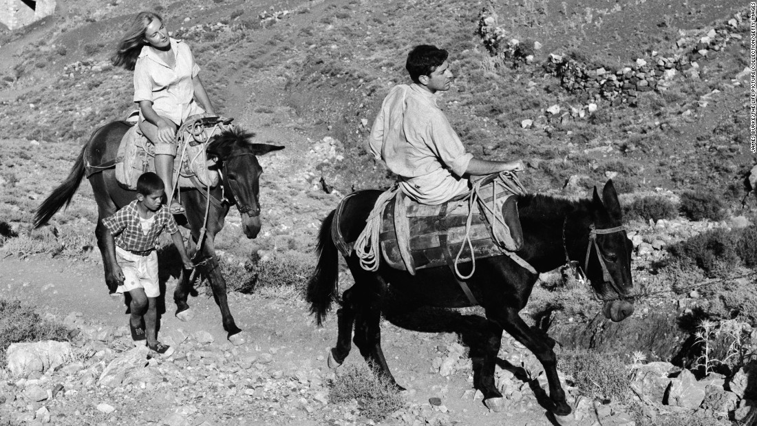 Cohen rides a mule along a stone path in Hydra, Greece, in October 1950. Cohen had bought a house on the island earlier in the year.