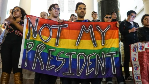 Protesters take part in a demonstration against Donald Trump