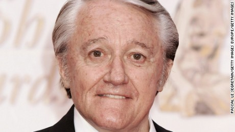 Actor Robert Vaughn poses as he arrives to attend the Gold Nymph awards ceremony at the 44th Monte-Carlo Television Festival on July 3, 2004 in Monte Carlo, Monaco.  (Photo by Pascal Le Segretain/Getty Images)
