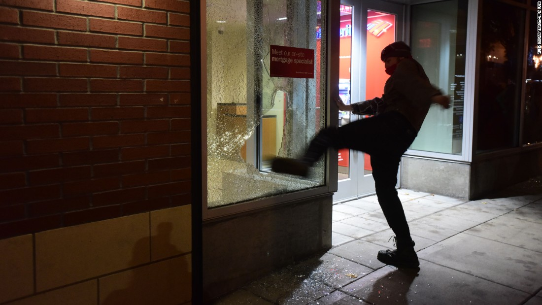 "A protester kicks the window of a Bank of America branch in Portland, Oregon, on November 10. What started out as a peaceful march with more than 4,000 people <a href=""http://www.cnn.com/2016/11/11/us/oregon-protest-riot/index.html"" target=""_blank"">quickly turned violent.</a> Portland police publicly declared a ""riot"" because of ""extensive criminal and dangerous behavior,"" according to posts on the department's Twitter page."