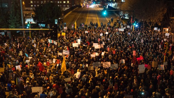 MINNEAPOLIS, MN - NOVEMBER 10: Protesters of President-elect Donald Trump gather in an intersection outside the Humphrey School of Affairs on the campus of the University of Minnesota on November 10, 2016 in Minneapolis, Minnesota. Thousands of people across the country have taken to the streets in protest in the days following the election of Republican Donald Trump over Democrat Hillary Clinton.   (Photo by Stephen Maturen/Getty Images)