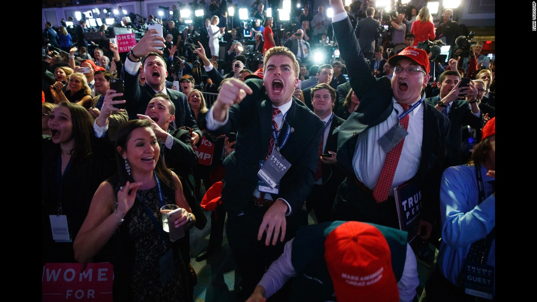 "Donald Trump supporters cheer as they watch election results in New York on Tuesday, November 8. Entering <a href=""http://www.cnn.com/2016/11/08/politics/gallery/election-day-2016/index.html"" target=""_blank"">Election Day,</a> Trump's chances of winning were seen as remote; most polls showed Hillary Clinton with marginal but steady leads. But Trump swept swing states such as Florida and North Carolina and pulled off unexpected wins in Wisconsin and Pennsylvania <a href=""http://www.cnn.com/2016/11/09/politics/donald-trump-hillary-clinton-popular-vote/"" target=""_blank"">on his way to victory.</a>"