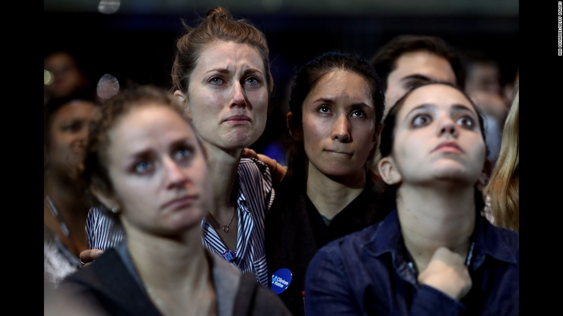 People react to election results at the Javits Center, where Hillary Clinton was holding an election night event in New York on Tuesday, November 8.