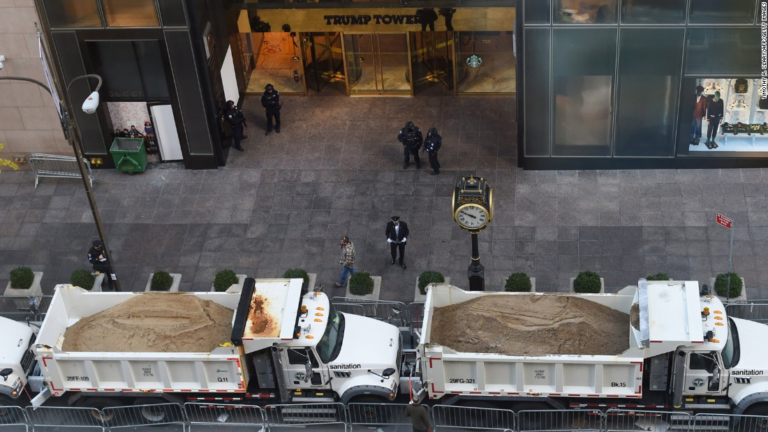 Trucks are parked in front of New York's Trump Tower to provide a protective barrier for President-elect Donald Trump on Thursday, November 10.