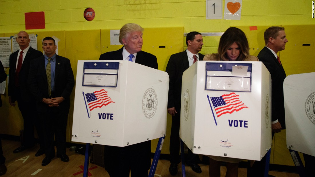 "Donald Trump looks at his wife, Melania, as they cast their votes in New York on <a href=""http://www.cnn.com/2016/11/08/politics/gallery/election-day-2016/index.html"" target=""_blank"">Election Day.</a>"