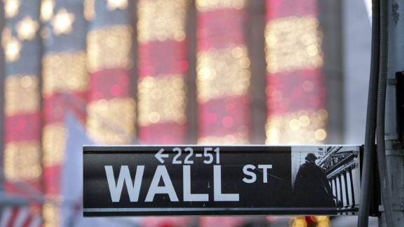 NEW YORK - DECEMBER 21:  A Wall Street sign is seen in front of the New York Stock Exchange December 21, 2006 in New York City. Wall Street