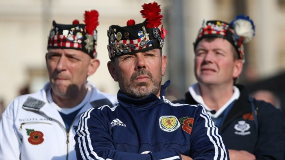 Scotland football fans stand in London