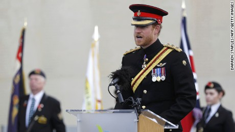 Prince Harry read a war poem after laying a wreath at the Armed Forces Memorial.