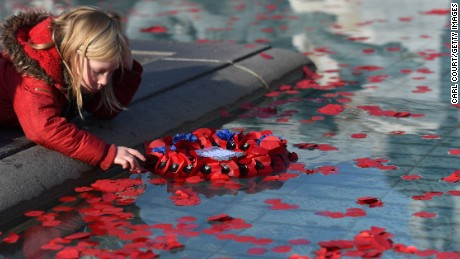Members of the public were invited to place poppies in the fountains at Trafalgar Square.