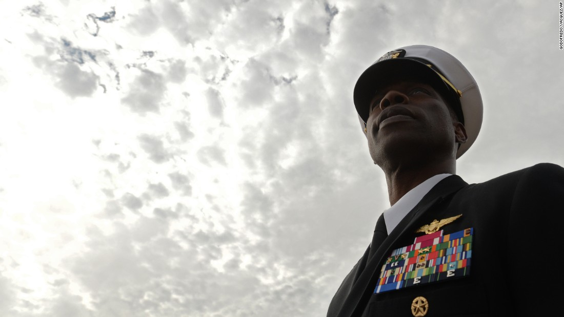 Navy Capt. Donald Nisbett, commanding officer of the Naval ROTC at Oregon State University, watches a Veterans Day parade in Albany, Oregon, on Friday.