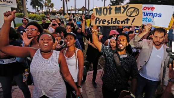 Demonstrators chant during a protest in opposition of President-elect Donald Trump, Friday, Nov. 11, 2016, at Bayfront Park in Miami. (Al Diaz/Miami Herald via AP)