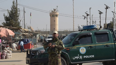 An Afghan security personnel keeps watch near the largest US military base in Bagram after an explosion on November 12. Four people were killed in an explosion inside the largest US military base in Afghanistan, NATO said, with local officials blaming a suicide attacker posing as a labourer for the major security breach.