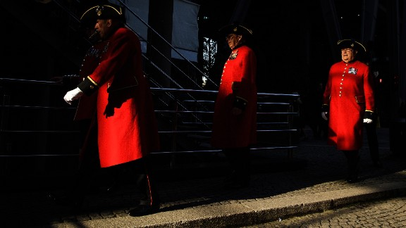 Chelsea Pensioners walk past the Lloyd