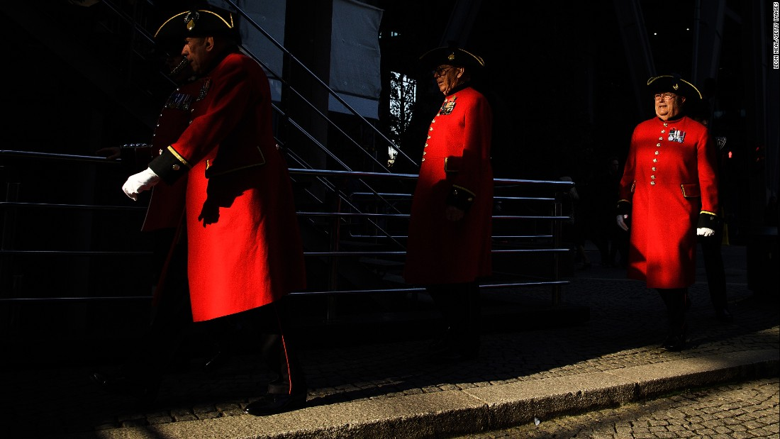 Chelsea Pensioners walk past the Lloyd's building following two minutes of silence for Remembrance Day on November 11 in London, England.