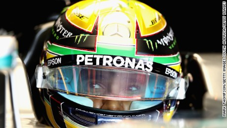 Lewis Hamilton beat his rival Nico Rosberg to pole position in Brazil by a tenth of a second.