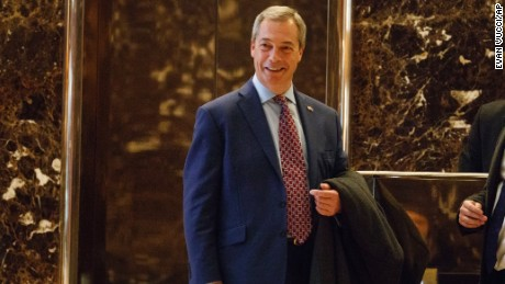 U.K. Independence Party leader Nigel Farage smiles as he arrives at Trump Tower, Saturday, Nov. 12, 2016, in New York.