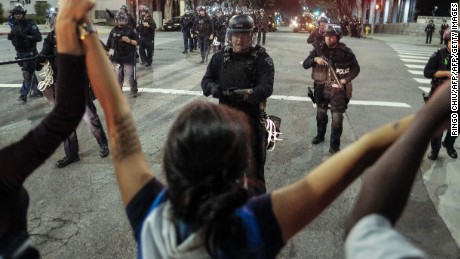 Police confront demonstrators outside City Hall in Los Angeles on Sunday.