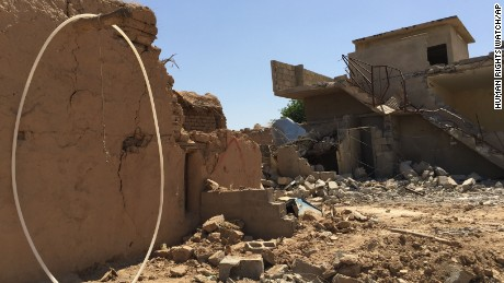 In this handout image provided by Human Rights Watch, destroyed houses are seen in Qarah Tappah, Iraq, with partial red X still visible, May 20, 2016.