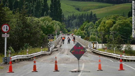 Emergency services inspect a bridge crossing the Waiau River, 110 kms north of Christchurch, as damage and land slip cause infrastructure disruption in the aftermath of a 7.5 magnitude earthquake.
