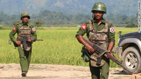 In this photograph taken on October 21, 2016, armed Myanmar army soldiers patrol a village in Maungdaw located in Rakhine State