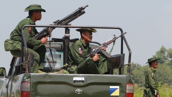 Heavily armed Myanmar army troops patrol Kyinkanpyin area in Maungdaw town located in Rakhine near the Bangladesh border on October 16, 2016. Three police officers were attacked with machetes in restive northwestern Myanmar on October 15 by assailants who were shot dead, the military has said, amid lethal violence that authorities have blamed on homegrown Islamist insurgents. Security forces have killed at least 29 people since attacks were launched the previous week on police posts along the Bangladesh border, according to state media. / AFP / KHINE HTOO MRAT        (Photo credit should read KHINE HTOO MRAT/AFP/Getty Images)